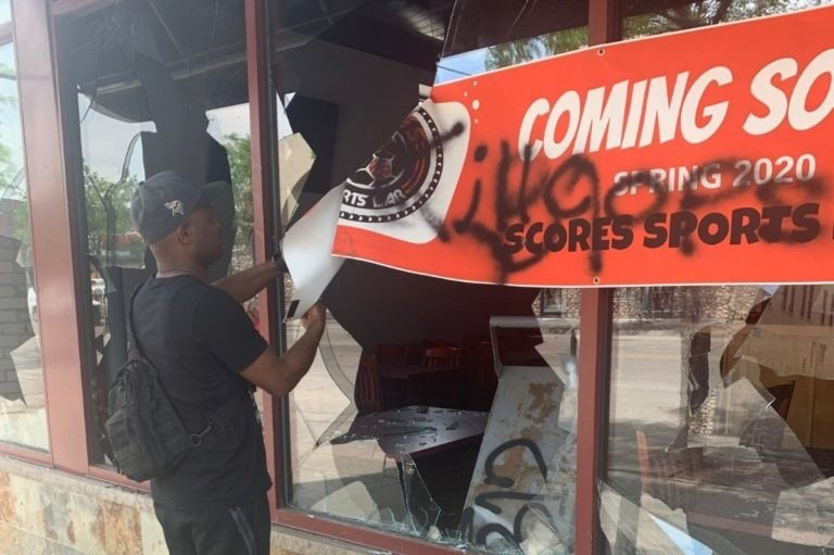 charitable individuals raise $300k for a business destroyed by looters